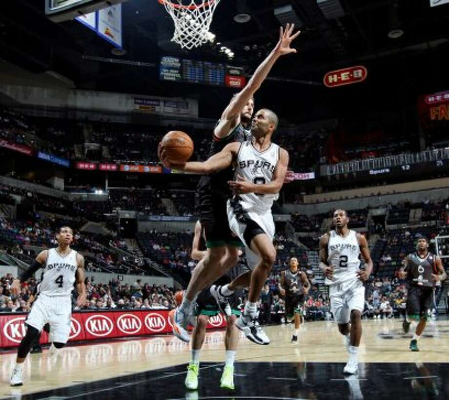San Antonio Spurs' Tony Parker shoots around Montepaschi Siena's Viktor Sanikidze during first half action Saturday Oct. 6, 2012 at the AT&T Center. (San Antonio Express-News)