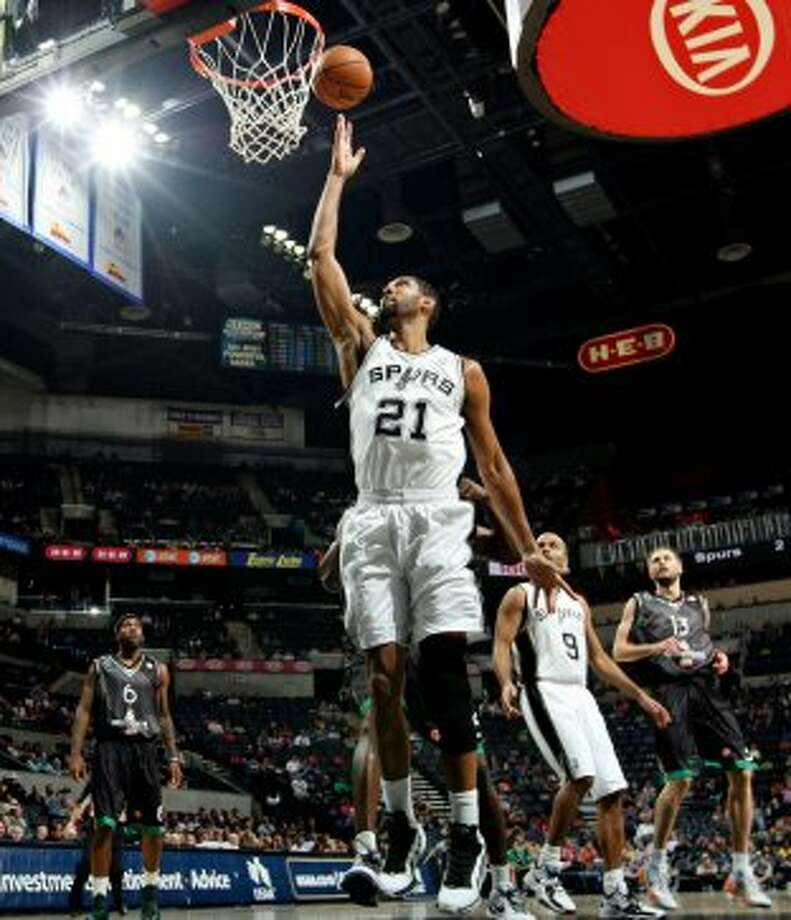 San Antonio Spurs' Tim Duncan shoots against Montepaschi Siena during first half action Saturday Oct. 6, 2012 at the AT&T Center. (San Antonio Express-News)