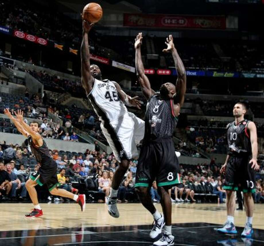 San Antonio Spurs' DeJuan Blair shoots around Montepaschi Siena's Benjamin Eze during second half action Saturday Oct. 6, 2012 at the AT&T Center. The Spurs won 106-77. (San Antonio Express-News)