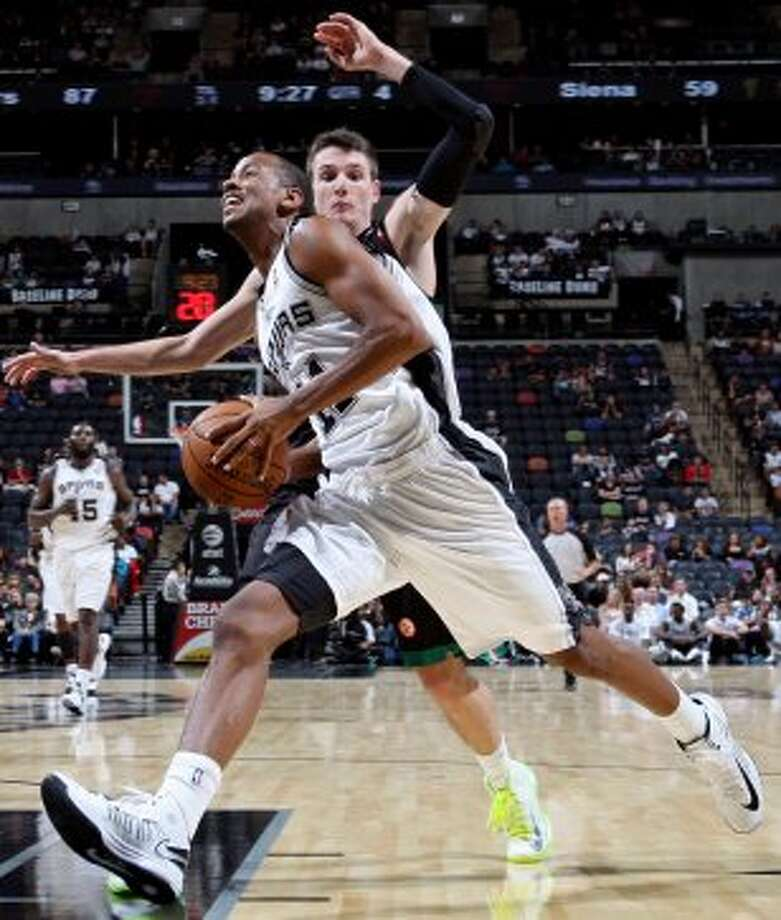 San Antonio Spurs' Wesley Witherspoon drives around Montepaschi Siena's Matt Janning during second half action Saturday Oct. 6, 2012 at the AT&T Center. The Spurs won 106-77. (San Antonio Express-News)