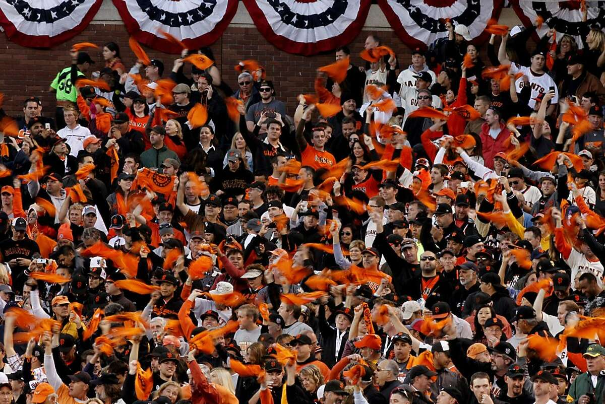 Giants fans cheer on their team waving rally towels, as the San Francisco GIants take on the Cincinnati Reds in game one of the National League Divisional Series at AT&T Park San Francisco, Calif., on Saturday October 6, 2012.