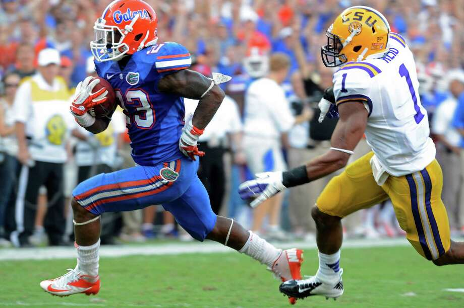 Florida's Mike Gillislee outruns LSU safety Eric Reid on his second rushing touchdown. Photo: Phil Sandlin / FR117487 AP