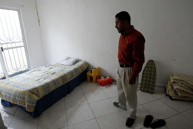 Pete Navarro, 33, takes a moment his bedroom of a rented house in the Monterrey, Mexico suburb of Apodaca, Thursday, Sept. 27, 2012. Navarro, once a resident alien, was deported three years ago due to two misdemeanor charges early in his adult life. Navarro was raised in San Antonio and doesn't speak Spanish. He left behind two sons in the care of his parents. His English skills landed him a job at Global Telesourcing, a U.S.-owned call center that specializes in providing operators with great English skills. Photo: Jerry Lara, San Antonio Express-News / © 2012 San Antonio Express-News