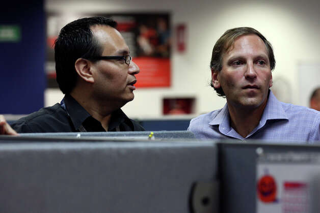Global Telesourcing's Jaime Amaro, 39, left, talks with company president Bill Colton, at the center's site in Monterrey, Mexico, Wednesday, Sept. 26, 2012. Amaro, born in Mexico, grew up in Houston but decided to move back to Monterrey. He started at the company as a telemarketer and worked his way up to site director. Photo: Jerry Lara, San Antonio Express-News / © 2012 San Antonio Express-News