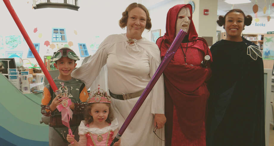 Michael and Gabrielle Prisciandaro with costumed Fairfield Public Library staffers Cindy Barich, Val Fredericks and Merry Uk for Saturday's observance of Star Wars Reads Day. Photo: Mike Lauterborn / Fairfield Citizen contributed
