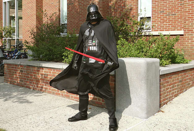 Chris Eriksson, dressed as Darth Vader, outside Fairfield Public Library on Saturday, marking Star Wars Reads Day. Photo: Mike Lauterborn / Fairfield Citizen contributed
