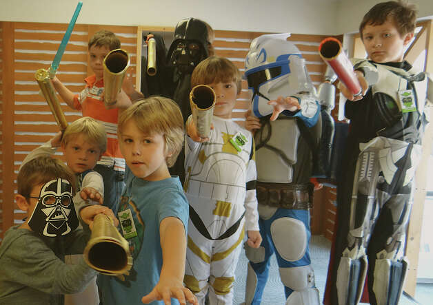 Light sabers at the ready, young Skywalkers enjoy Star Wars Reads Day at the Fairfield Public Library on Saturday. Photo: Mike Lauterborn / Fairfield Citizen contributed