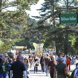 Crowds walk by the newly named Hellman Hollow for the second day of Hardly Strictly Bluegrass in Golden Gate Park in San Francisco, CA on October 6, 2012.