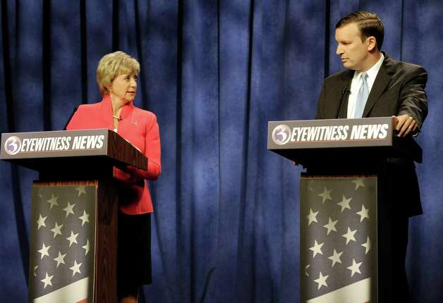 Republican candidate for U.S. Senate Linda McMahon addresses Democratic candidate for U.S. Senate Chris Murphy during a live televised debate in Rocky Hill, Conn., Sunday, Oct. 7, 2012. The two are vying for the Senate seat now held by Joe Lieberman, an independent who's retiring. A recent Quinnipiac University poll shows the race is a dead heat. Photo: Jessica Hill