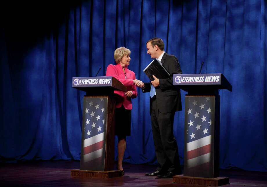 Republican candidate for U.S. Senate Linda McMahon, left, shakes hands with Democratic candidate for U.S. Senate Chris Murphy at the end of a live televised debate in Rocky Hill, Conn., Sunday, Oct. 7, 2012. The two are vying for the Senate seat now held by Joe Lieberman, an independent who's retiring. A recent Quinnipiac University poll shows the race is a dead heat. Photo: Jessica Hill