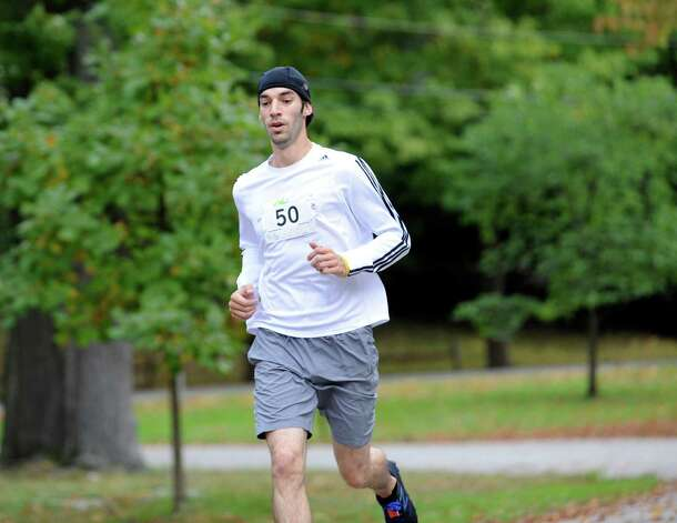 Philip Benson, of Peekskill, N.Y., was the top overall finisher at the seventh John Zumbo 5K Race in Bruce Park Sunday, Oct. 7, 2012. The race benefits the John D. Zumbo Memorial Scholarship Fund, which provides scholarships to Greenwich High School graduates who plan to go to college and study in the health or fitness field. Photo: Helen Neafsey / Greenwich Time