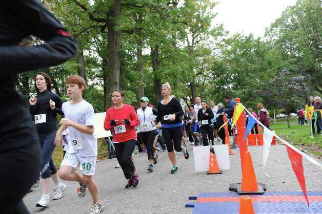 The start of the seventh John Zumbo 5K Race in Bruce Park Sunday, Oct. 7, 2012. The race benefits the John D. Zumbo Memorial Scholarship Fund, which provides scholarships to Greenwich High School graduates who plan to go to college and study in the health or fitness field. Photo: Helen Neafsey / Greenwich Time
