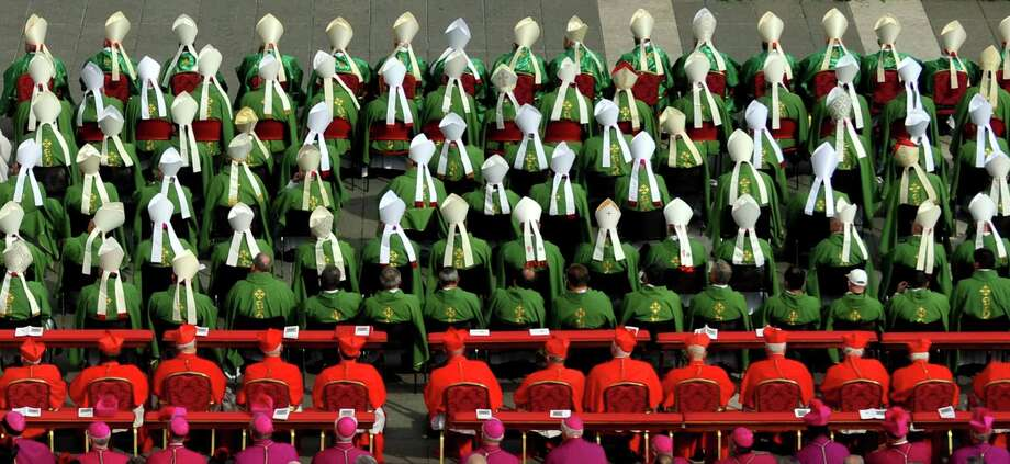 Bishops and cardinals attends a  mass celebrated by Pope Benedict XVI  for the opening of the Synod of bishops on October 7, 2012 at St Peter's Square at the Vatican.  Photo: TIZIANA FABI, AFP/Getty Images / AFP
