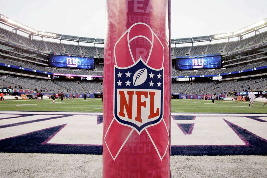 A pink goal post padding is used during Breast Cancer Awareness month as players warm up before an NFL football game between the New York Giants and the Cleveland Browns Sunday, Oct. 7, 2012, in East Rutherford, N.J. (AP Photo/Peter Morgan) Photo: Peter Morgan / AP