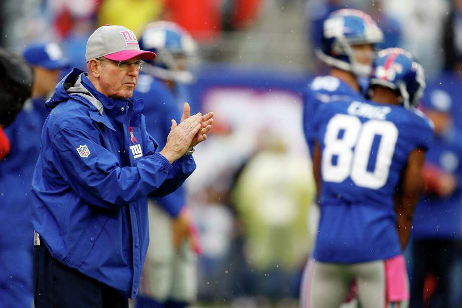 New York Giants head coach Tom Coughlin claps while talking to his team before an NFL football game against the Cleveland Browns  Sunday, Oct. 7, 2012, in East Rutherford, N.J. (AP Photo/Julio Cortez) Photo: Julio Cortez / AP
