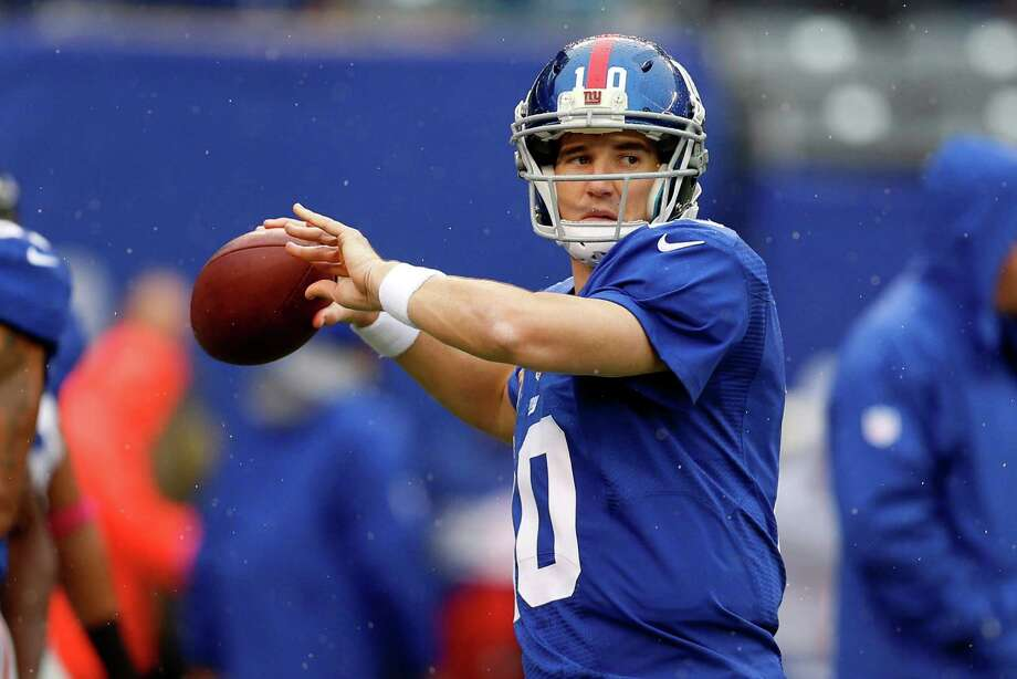 New York Giants quarterback Eli Manning (10) warms up before an NFL football game against the Cleveland Browns Sunday, Oct. 7, 2012, in East Rutherford, N.J. (AP Photo/Julio Cortez) Photo: Julio Cortez / AP