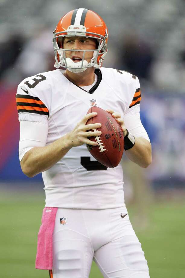 Cleveland Browns quarterback Brandon Weeden (3) warms up before an NFL football game against the New York Giants Sunday, Oct. 7, 2012, in East Rutherford, N.J. (AP Photo/Kathy Willens) Photo: Kathy Willens / AP