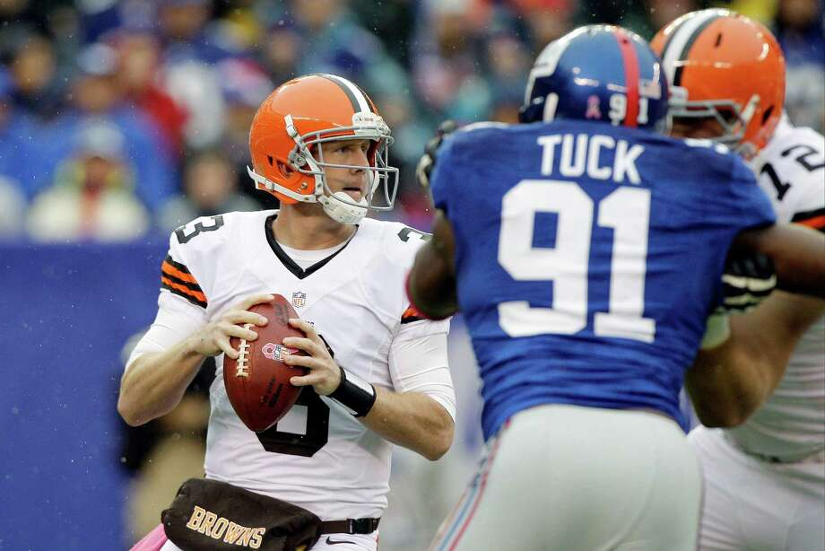 Cleveland Browns quarterback Brandon Weeden (3) looks to pass as New York Giants defensive end Justin Tuck (91) rushes the passer during the first half of an NFL football game Sunday, Oct. 7, 2012, in East Rutherford, N.J. (AP Photo/Kathy Willens) Photo: Kathy Willens / AP