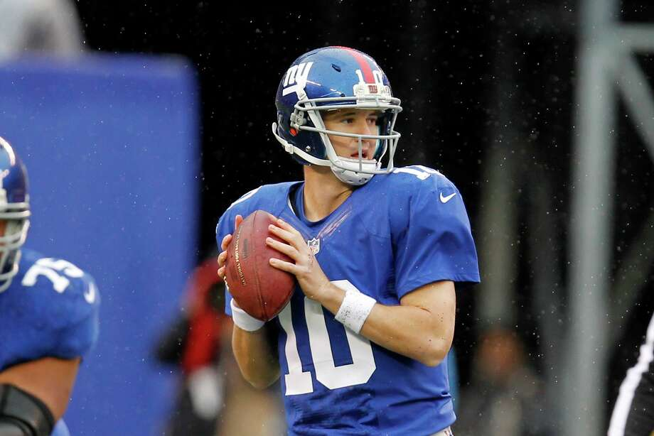 New York Giants quarterback Eli Manning (10) looks to pass during the first half of an NFL football game against the Cleveland Browns Sunday, Oct. 7, 2012, in East Rutherford, N.J. (AP Photo/Julio Cortez) Photo: Julio Cortez / AP