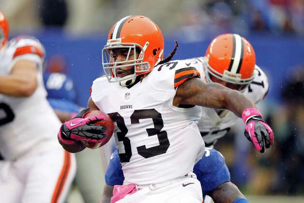 Cleveland Browns running back Trent Richardson (33) rushes during the first half of an NFL football game against the New York Giants Sunday, Oct. 7, 2012, in East Rutherford, N.J. (AP Photo/Julio Cortez) Photo: Julio Cortez / AP