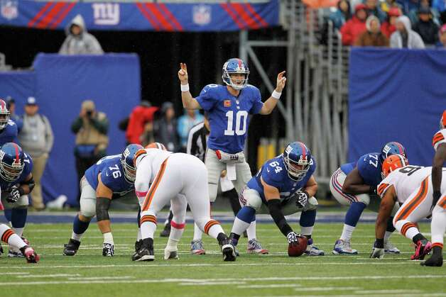 New York Giants quarterback Eli Manning (10) looks over the defense before snapping the ball during the first half of an NFL football game against the Cleveland Browns Sunday, Oct. 7, 2012, in East Rutherford, N.J. (AP Photo/Julio Cortez) Photo: Julio Cortez / AP