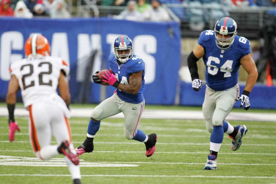 New York Giants running back Ahmad Bradshaw (44) rushes during the first half of an NFL football game against the Cleveland Browns Sunday, Oct. 7, 2012, in East Rutherford, N.J. (AP Photo/Julio Cortez) Photo: Julio Cortez / AP