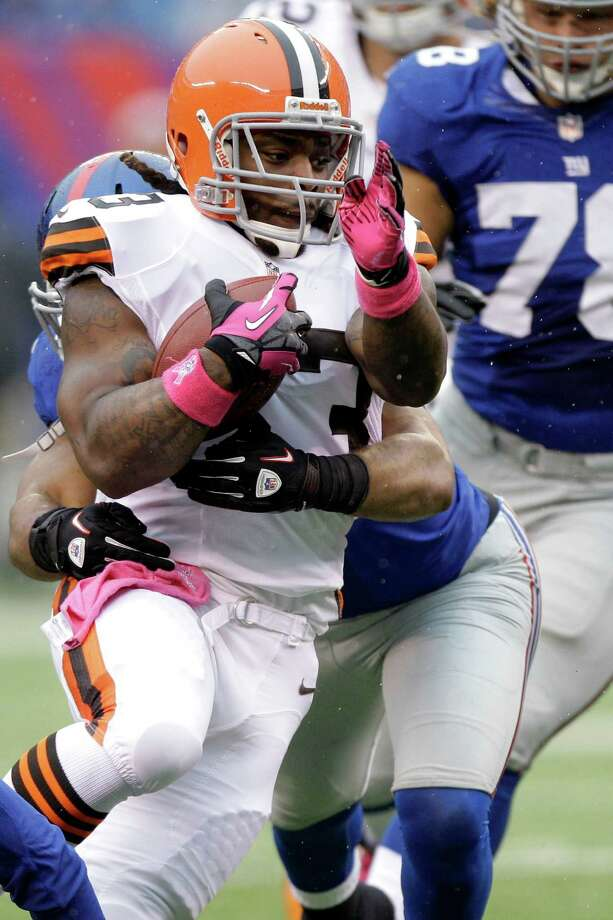 Cleveland Browns running back Trent Richardson (33) is tackled by New York Giants linebacker Spencer Paysinger during the first half of an NFL football game Sunday, Oct. 7, 2012, in East Rutherford, N.J. (AP Photo/Kathy Willens) Photo: Kathy Willens / AP