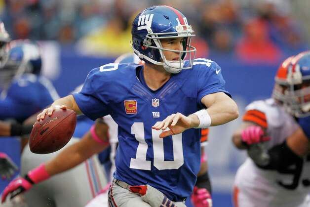 New York Giants quarterback Eli Manning (10) throws a pass during the first half of an NFL football game against the Cleveland Browns Sunday, Oct. 7, 2012, in East Rutherford, N.J. (AP Photo/Julio Cortez) Photo: Julio Cortez / AP
