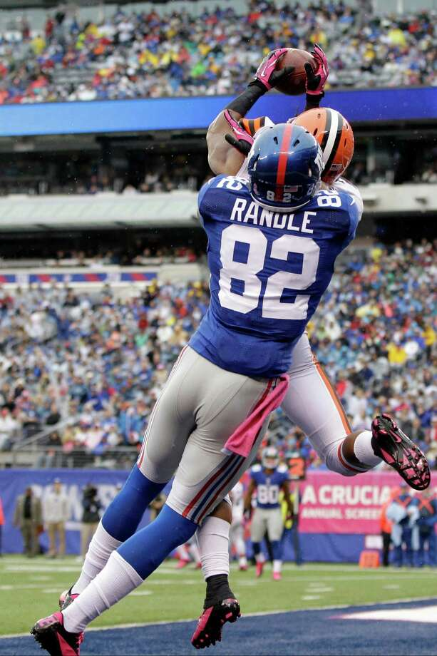 Cleveland Browns defensive back Buster Skrine (22) defends a pass to New York Giants wide receiver Rueben Randle (82)during the first half of an NFL football game Sunday, Oct. 7, 2012, in East Rutherford, N.J. (AP Photo/Kathy Willens) Photo: Kathy Willens / AP