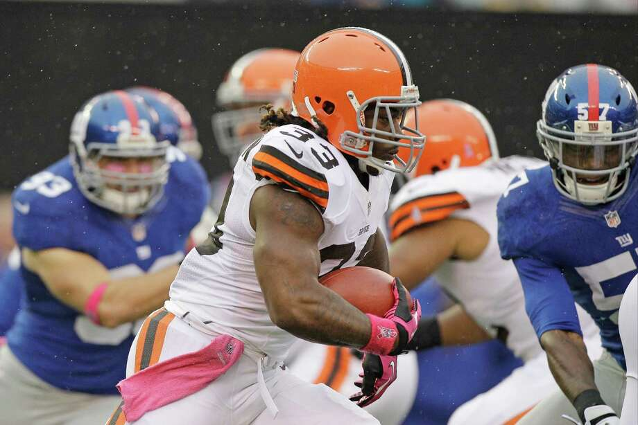 Cleveland Browns running back Trent Richardson (33) rushes during the first half of an NFL football game against the New York Giants Sunday, Oct. 7, 2012, in East Rutherford, N.J. (AP Photo/Kathy Willens) Photo: Kathy Willens / AP