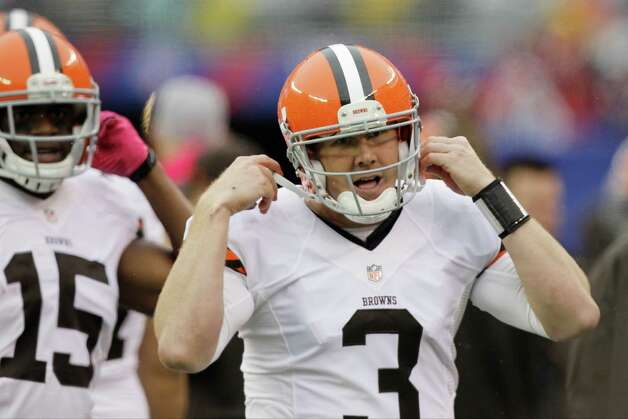 Cleveland Browns quarterback Brandon Weeden (3) takes his helmet off as he walks off the field during the first half of an NFL football game against the New York Giants Sunday, Oct. 7, 2012, in East Rutherford, N.J. (AP Photo/Kathy Willens) Photo: Kathy Willens / AP