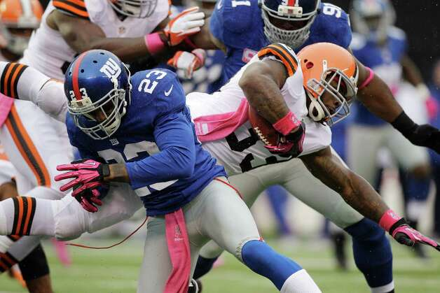 Cleveland Browns running back Trent Richardson (33) dives past New York Giants cornerback Corey Webster (23) during the first half of an NFL football game Sunday, Oct. 7, 2012, in East Rutherford, N.J. (AP Photo/Kathy Willens) Photo: Kathy Willens / AP