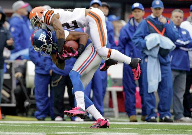 Cleveland Browns defensive back Buster Skrine (22) makes a tackle during the first half of an NFL football game against the New York Giants Sunday, Oct. 7, 2012, in East Rutherford, N.J. (AP Photo/Kathy Willens) Photo: Kathy Willens / AP