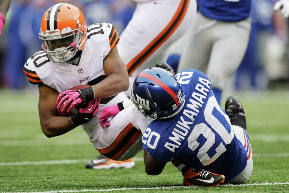 New York Giants defensive back Prince Amukamara (20) tackles Cleveland Browns wide receiver Jordan Norwood (10) during the first half of an NFL football game Sunday, Oct. 7, 2012, in East Rutherford, N.J. (AP Photo/Kathy Willens) Photo: Kathy Willens / AP