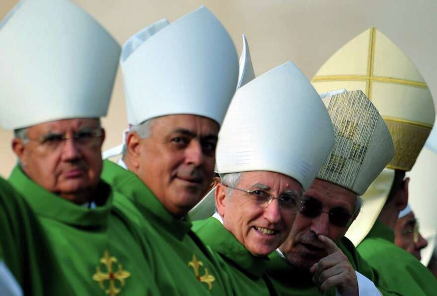 Bishops attends a mass celebrated by  Pope Benedict XVI for the opening of the Synod of bishops on O