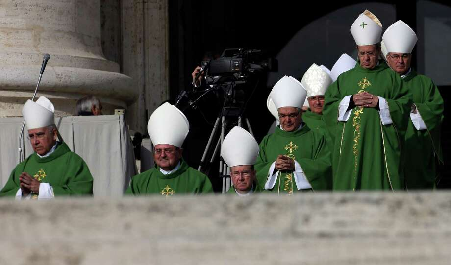 Bishops arrive to a Mass celebrated by Pope Benedict XVI  for the opening of the synod of bishops in St. Peter square at the Vatican, Sunday, Oct. 7 , 2012. Photo: Alessandra Tarantino, Associated Press / AP