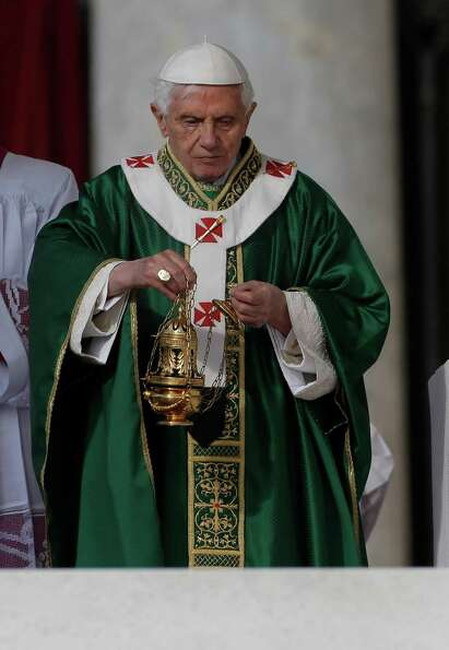 Pope Benedict XVI spreads incense as he celebrates a Mass for the opening of the synod of bishops in
