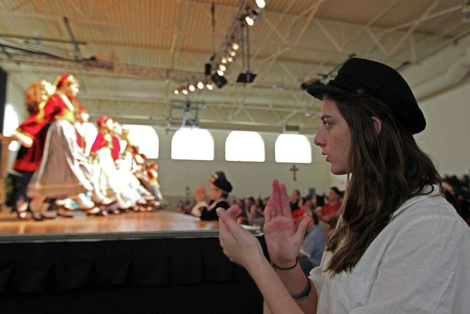 Sophie Pappas claps to the beat of the music during a children's dance performance at The Original Greek Festival at the Annunciation Orthodox Cathedral Sunday, Oct. 7, 2012, in Houston. Photo: James Nielsen, Chronicle / © Houston Chronicle 2012
