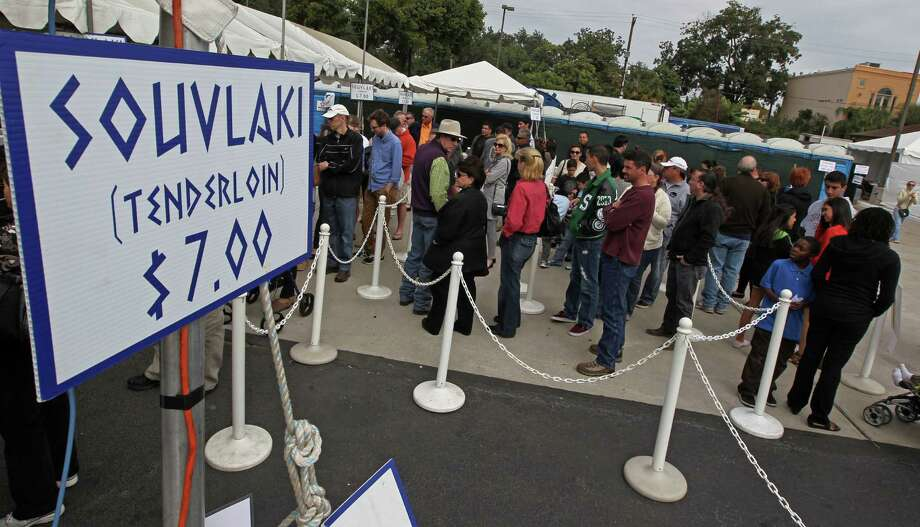 A line forms for the Souvlaki during The Original Greek Festival at the Annunciation Orthodox Cathedral Sunday, Oct. 7, 2012, in Houston. The festival prepared 21,168 Souvlaki tenderloin and onion kabobs for the four day festival. Photo: James Nielsen, Chronicle / © Houston Chronicle 2012