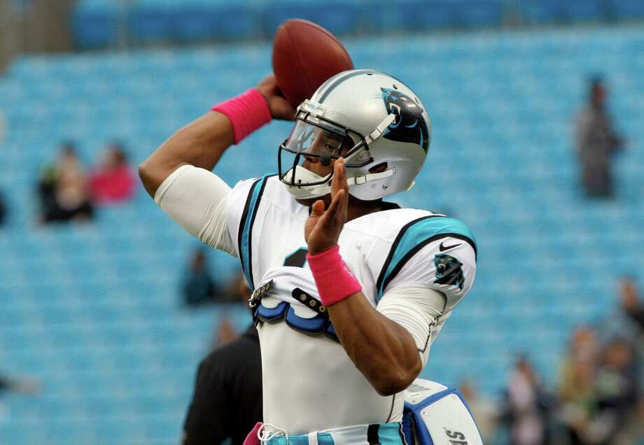 Carolina Panthers' Cam Newton (1) warms up before an NFL football game against the Seattle Seahawks in Charlotte, N.C., Sunday, Oct. 7, 2012. Photo: AP