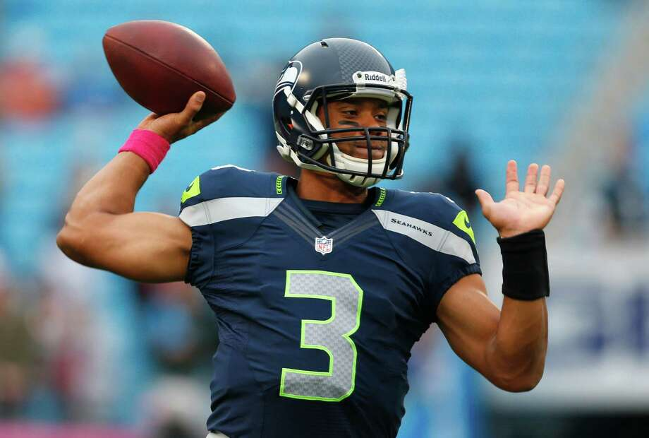 Seattle Seahawks' Russell Wilson (3) warms up before an NFL football game against the Carolina Panthers in Charlotte, N.C., Sunday, Oct. 7, 2012. Photo: AP