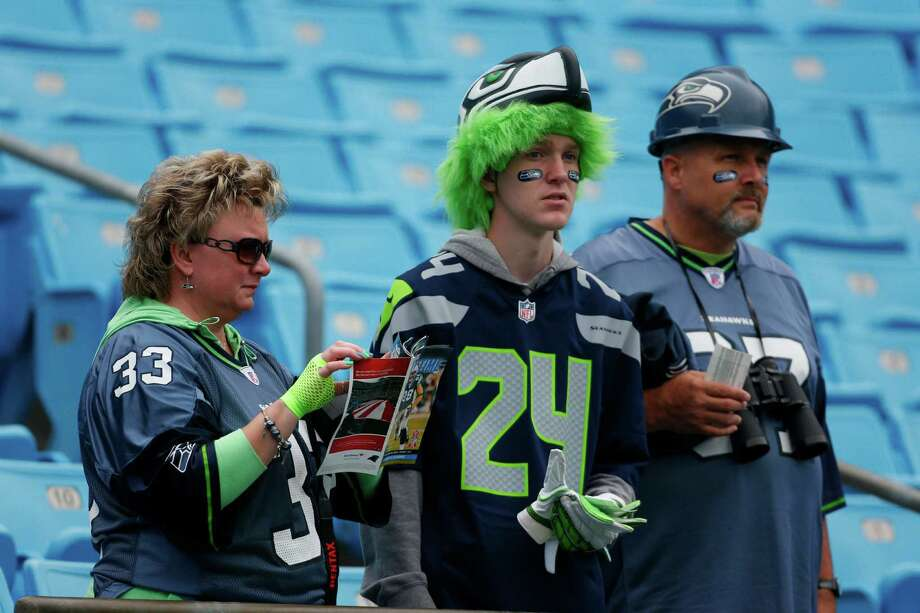 Seattle Seahawks fans watch their team warm up before an NFL football game against the Carolina Panthers in Charlotte, N.C., Sunday, Oct. 7, 2012. Photo: AP