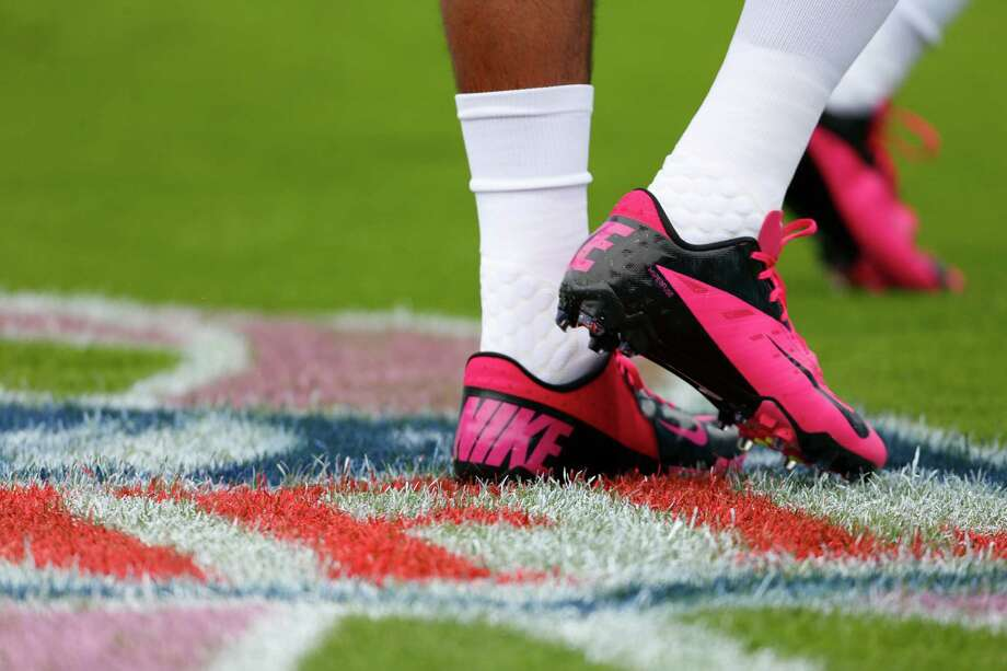 A Seattle Seahawks player wears pink shoes to support Breast Cancer Awareness Month before an NFL football game against the Carolina Panthers in Charlotte, N.C., Sunday, Oct. 7, 2012. Photo: AP