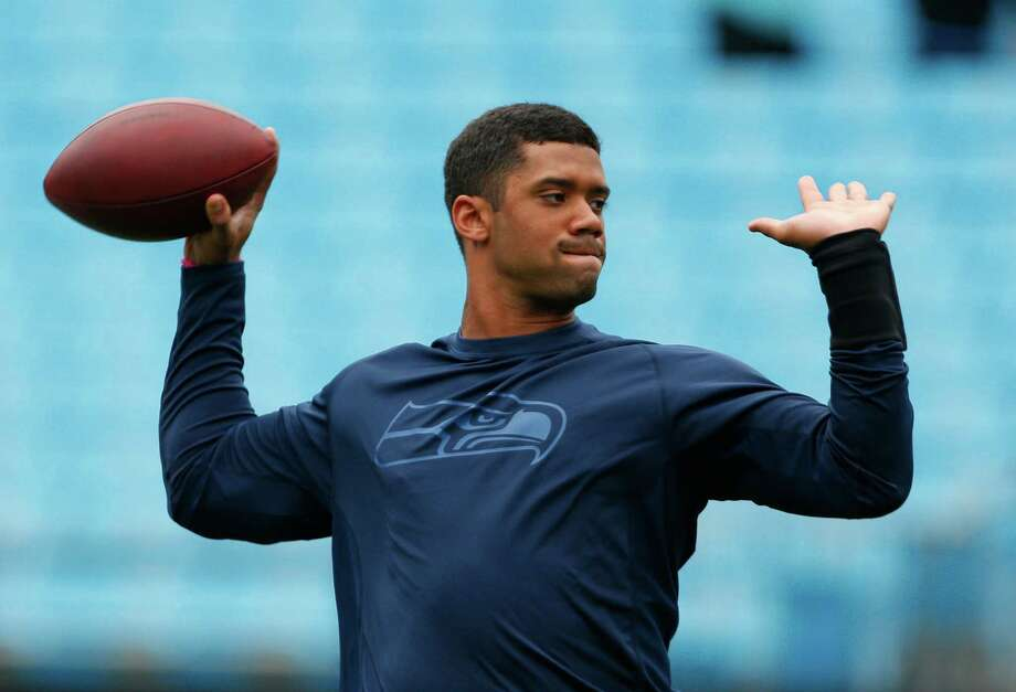 Seattle Seahawks' Russell Wilson warms up before an NFL football game against the Carolina Panthers in Charlotte, N.C., Sunday, Oct. 7, 2012. Photo: AP