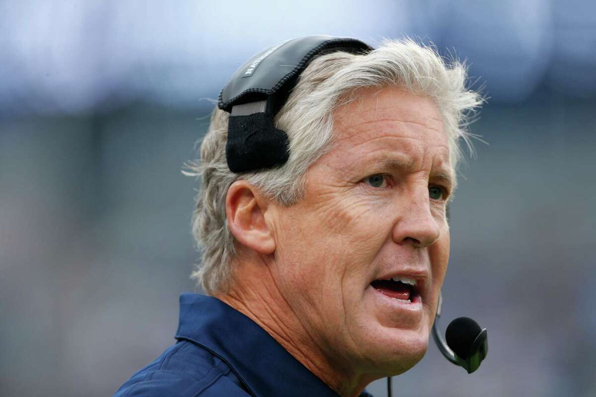 Seattle Seahawks head coach Pete Carroll looks on from the sidelines during the first quarter of an NFL football game against the Carolina Panthers in Charlotte, N.C., Sunday, Oct. 7, 2012.