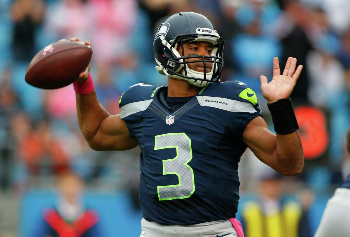 Seattle Seahawks' Russell Wilson (3) looks to pass against the Carolina Panthers during the first quarter of an NFL football game in Charlotte, N.C., Sunday, Oct. 7, 2012.