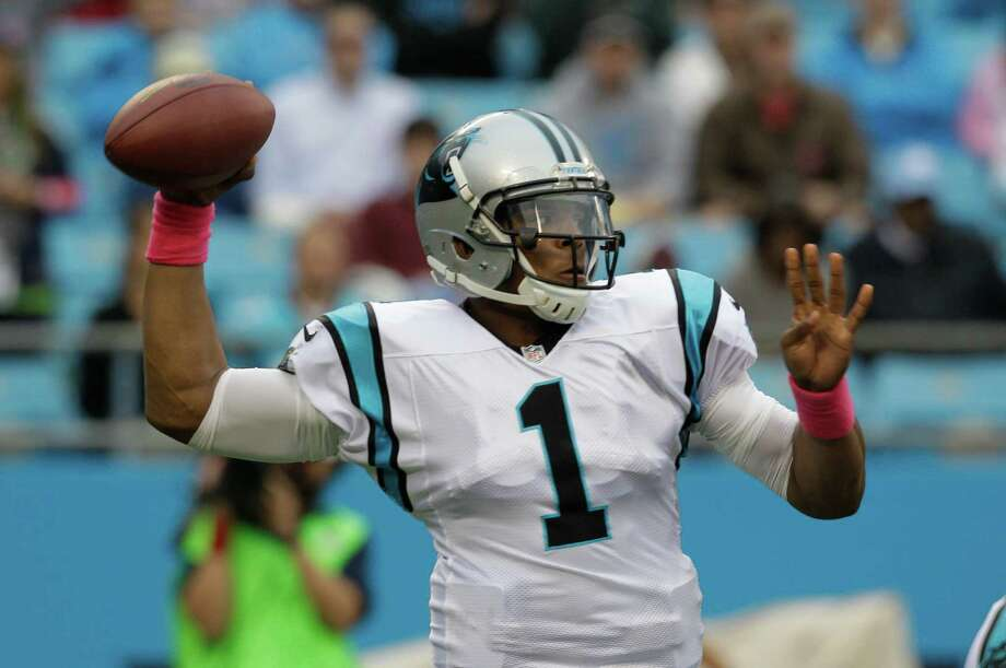 Carolina Panthers' Cam Newton (1) looks to pass against the Seattle Seahawks during the first quarter of an NFL football game in Charlotte, N.C., Sunday, Oct. 7, 2012. Photo: AP