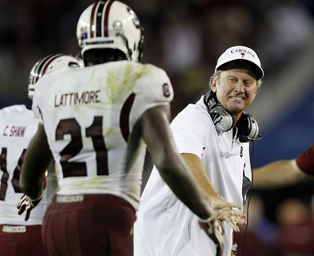 LEXINGTON, KY - SEPTEMBER 29: Head Coach Steve Spurrier of the South Carolina Gamecocks congratulates Marcus Lattimore #21 after running in a touchdown against the Kentucky Wildcats during the second half of play at Commonwealth Stadium on September 29, 2012 in Lexington, Kentucky. (Photo by John Sommers II/Getty Images)