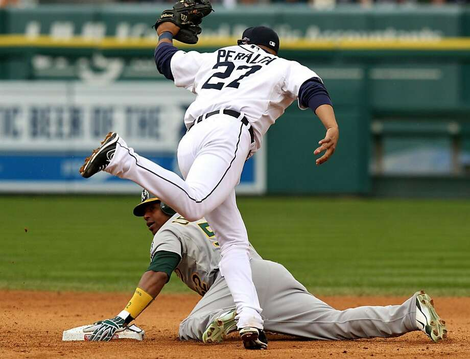 Oakland Athletics Yoenis Cespedes steals second base under Detroit Tigers Jhonny Peralta during their ALDS game Sunday October 7, 2012 in Detroit MI Photo: Lance Iversen, The Chronicle