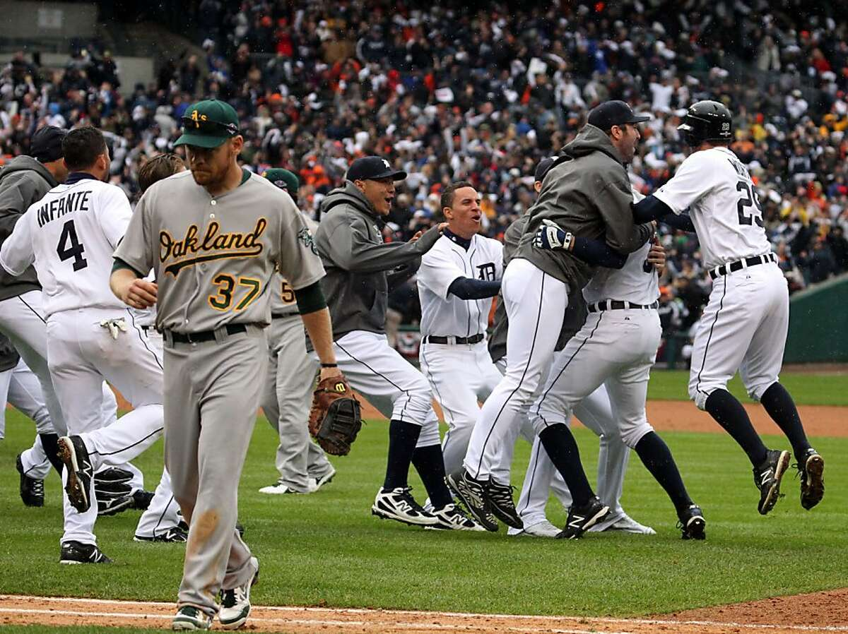 Detroit Tigers Don Kelly second from right is mobbed by his teammates after his walk-off sacrifice fly ball in the 9th inning against the Oakland Athletics. Tigers won 5-4 Sunday October 7, 2012 in Detroit MI
